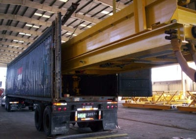 Automated parking machinery is loaded for shipment to the customer.