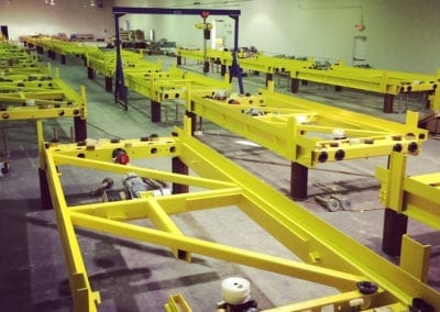 The robotic parking machinery is built and tested at our manufacturing facility in Florida, USA.
