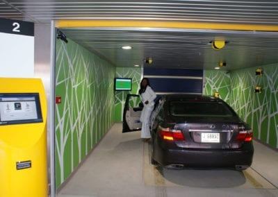 Get out, take the card from the kiosk and walk away. The Robotic Parking System does the rest.