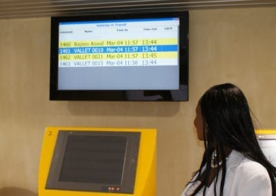 Screens display the exit terminal where the car can be retrieved.